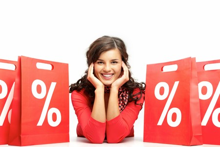 Portrait of a young girl among discount paper bags Stock Photo - 8015749