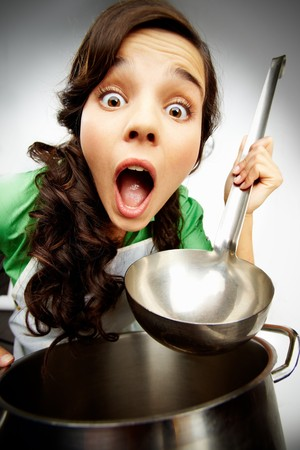 screaming head: Distorted image of a astonished woman with a ladle and saucepan