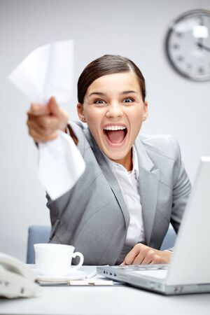 winning business woman: Image of young businesswoman shouting in luck Stock Photo