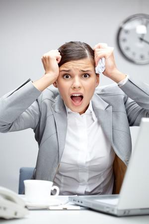 fiasco: Image of young employer touching her head in frustration at workplace Stock Photo