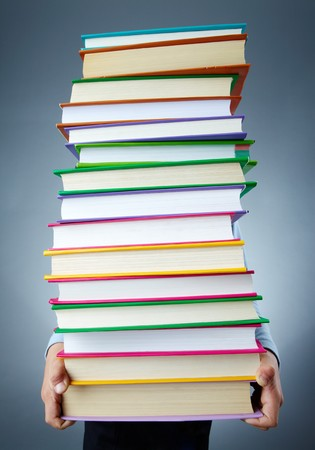Image of stack of books held by child Stock Photo - 8062466