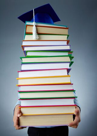 scientific literature: Image of stack of books held by child Stock Photo
