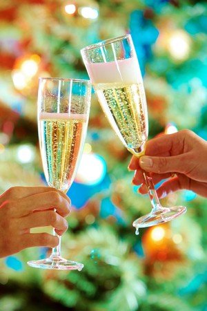 Close-up of hands holding flutes of champagne doing clink photo