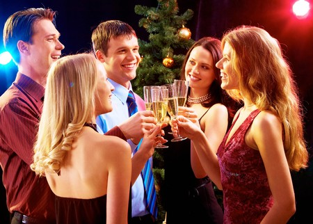 people celebrating: Portrait of several friends celebrating New Year  Stock Photo