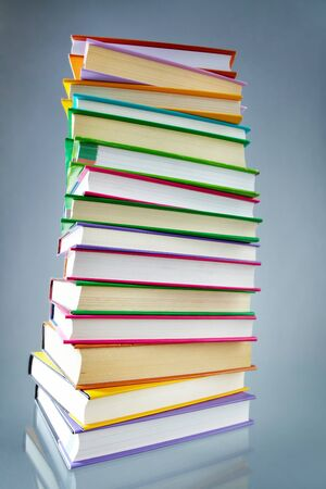scientific literature: Image of stack of books with colorful covers in isolation