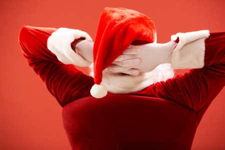new thinking: Back view of Santa Claus keeping his hands behind head