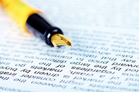 Close-up of fountain pen on document at workplace  photo