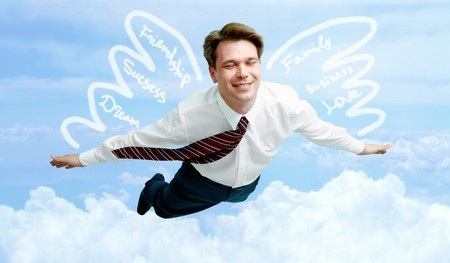 Conceptual image of smiling businessman with wings flying in the clouds Stock Photo - 8212371