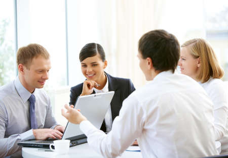Photo of confident employees planning work in office photo