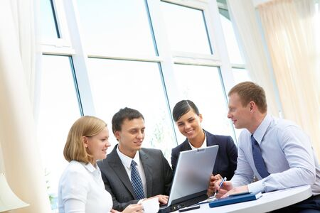 Photo of confident employees working round table in office Stock Photo - 8212387