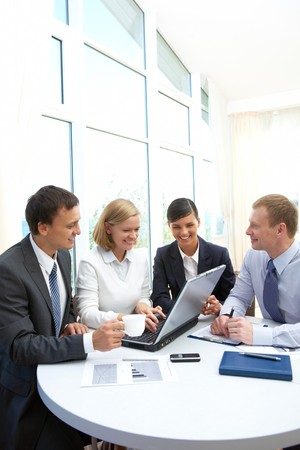 Photo of confident partners interacting at meeting in office Stock Photo - 8212386