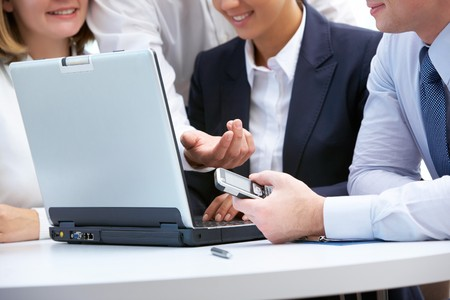 Close-up of business people aroung laptop working in group Stock Photo - 8212367