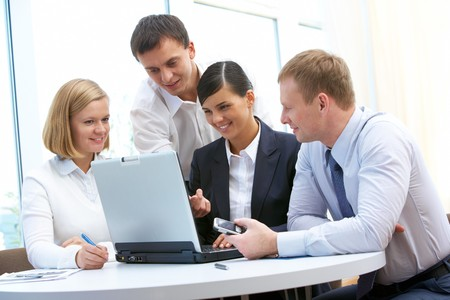 female executive: Photo of confident partners planning work at meeting in office