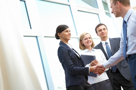business deal: Image of business partners making an agreement Stock Photo