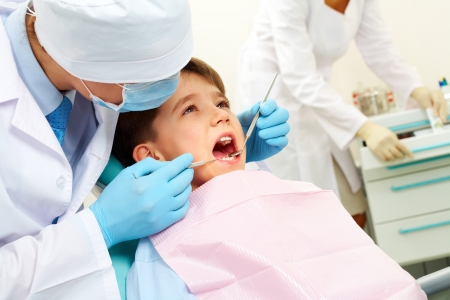 Image of dental examining being given to little boy by dentist Stock Photo - 8225958