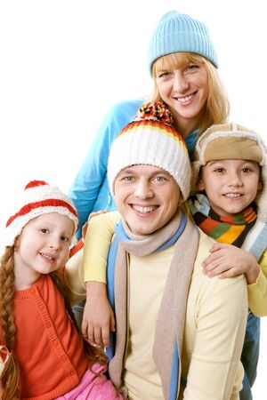 A happy family in winter clothing over white background Stock Photo - 8226500