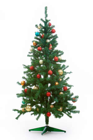 christmastide: Image of Christmas fir tree decorated with red and golden toy balls Stock Photo