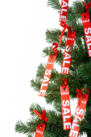 Part of Christmas fir tree decorated with red labels of sale photo