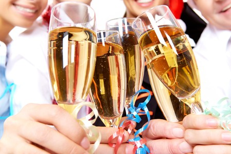 Image of crystal glasses full of champagne held by human hands Stock Photo - 8225910