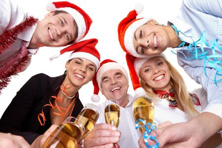 christmas drink: Portrait of smart colleagues with flutes of champagne wishing you Merry Christmas
