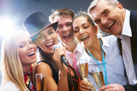 Photo of businesspeople with flutes of sparkling champagne singing Christmas songs Stock Photo - 8226535