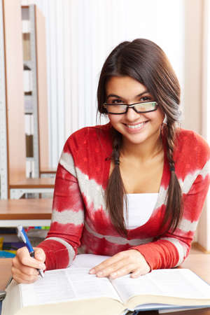 Portrait of clever student preparing lessons in college library Stock Photo - 8227070