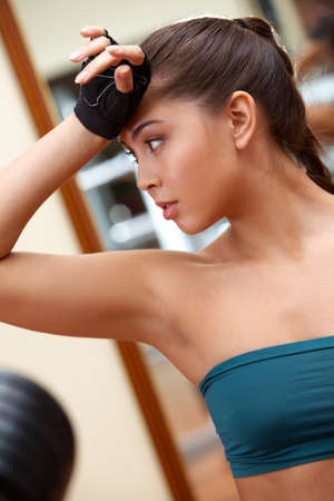 tanktop: Portrait of sporty brunette in tanktop after workout Stock Photo