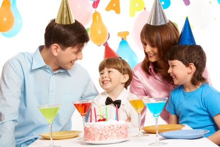 Portrait of happy boy having his birthday party with parents and elder brother near by Stock Photo - 8226494