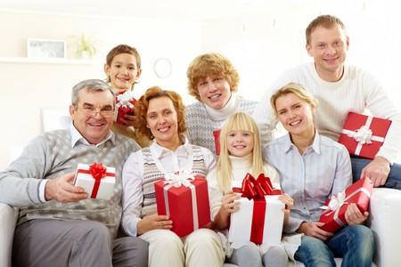 new home family: Portrait of senior and young couples and their children with giftboxes