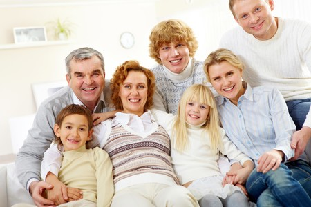 Portrait of senior and young couples with their children relaxing at home Stock Photo - 8227169