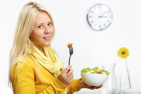 bawl: Portrait of a girl holding a bawl with salad Stock Photo