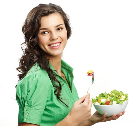 nutritious: Portrait of a girl with bawl of salad looking at camera