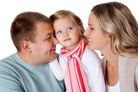Portrait of happy parents and their daughter in studio Stock Photo - 8227433