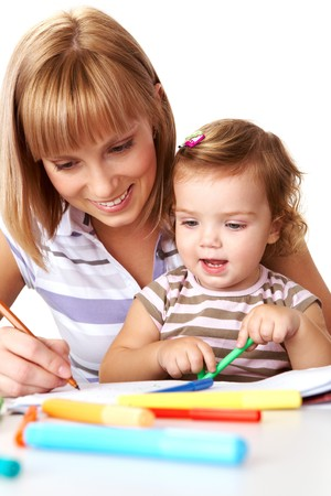 Photo of cute preschooler and her mother drawing photo