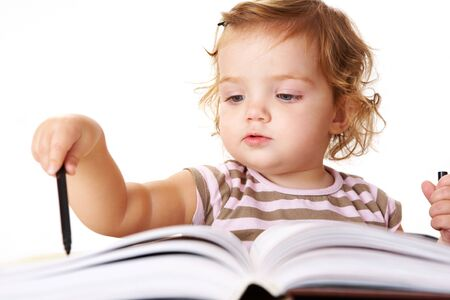 Photo of adorable girl with black highlighter in front of open book photo