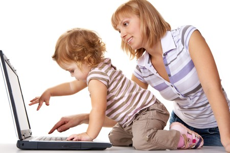 Photo of cute toddler and her mother looking at laptop display ready to press key Stock Photo - 8227283