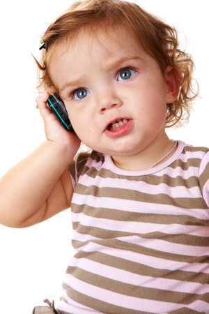 Portrait of cute toddler speaking by cellular phone Stock Photo - 8227350