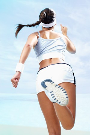girl in sportswear: Back view of a girl running against blue background