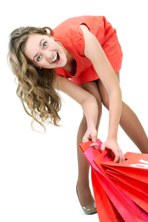 Portrait of happy girl with red paper bags looking at camera and smiling Stock Photo - 8227229