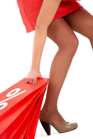Leg and arm of lady carrying red paper bags Stock Photo - 8227248