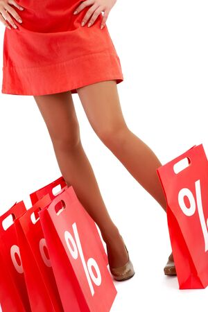 Legs of lady standing by red paper bags Stock Photo - 8226713