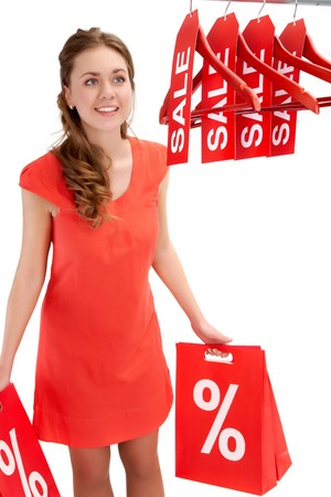 Happy shopper carrying bags and looking at hangers with discount symbols Stock Photo - 8227158