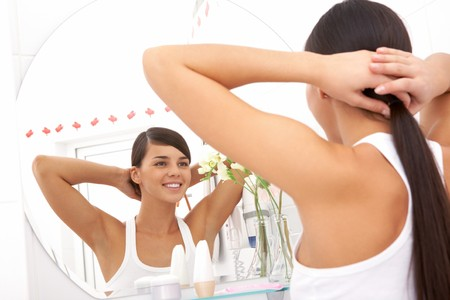 reflection in mirror: Image of pretty female looking in mirror in the morning