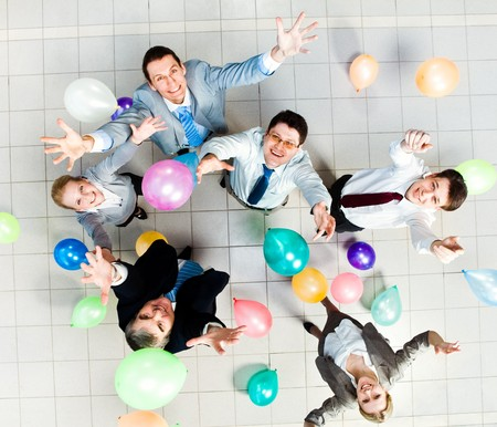 corporate group: Above view of joyful business people with balloons in air and on the floor