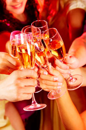Image of friends hands with crystal glasses full of champagne photo