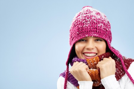 Photo of pretty woman in knitted winter cap and scarf looking at camera with smile photo