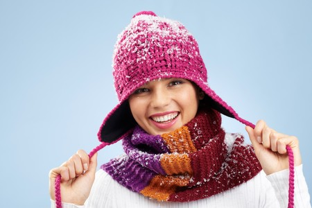 Photo of pretty woman in knitted winter cap and scarf looking at camera with smile Stock Photo - 8228643