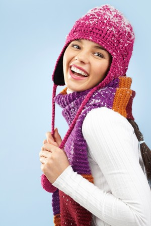 Photo of happy woman in knitted winter cap and scarf posing before camera photo