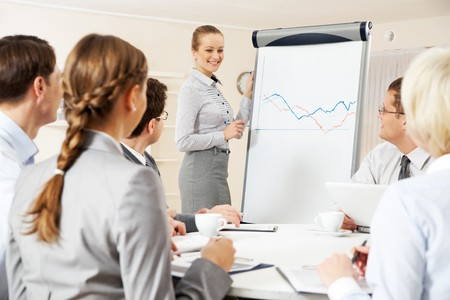 Photo of successful businesswoman presenting new project to partners photo