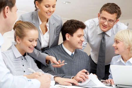 Image of confident businessman showing plan to colleagues   Stock Photo - 8228743